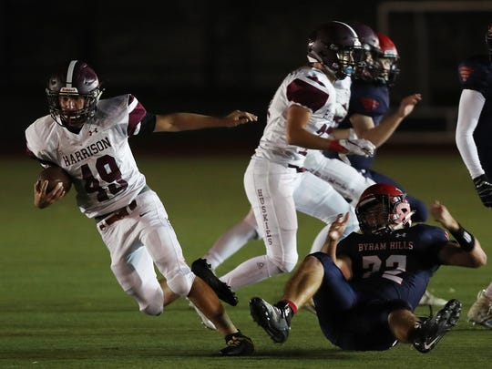 Harrison's Casey Judelson carries the ball during a game at Byram Hills High School on Sept. 28, 2018.
