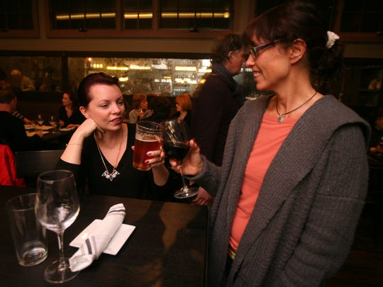 Heidi Normand-Berge from Piermont and Suzanne Robbins from Suffern chat and enjoy a drink at the bar at Dvine Bar in Sparkill.