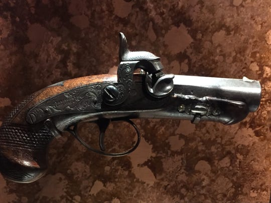 """Columnist Billy Watkins called it """"chilling"""" to see the actual derringer John Wilkes Booth used to assassinate President Abraham Lincoln in 1865. It is on display, along with many Lincoln artifacts, at Ford's Theatre, where the shooting occurred."""