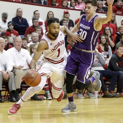Indiana's James Blackmon Jr. is defended by Northwestern's
