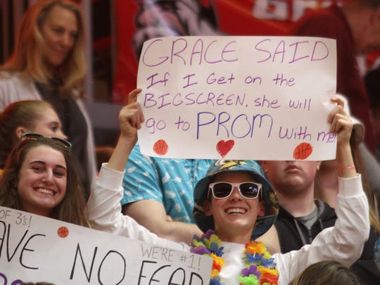 An Indianola fan makes a pitch to get Indianola junior Grace Berg to go to prom with him during last year's state basketball tournament at Wells Fargo Arena.