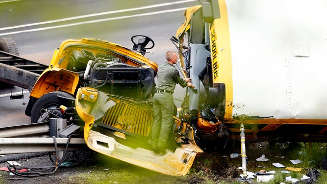 A school bus carrying middle school students from Paramus was ripped from its chassis in an accident with a dump truck on Route 80 west May 17, 2018.