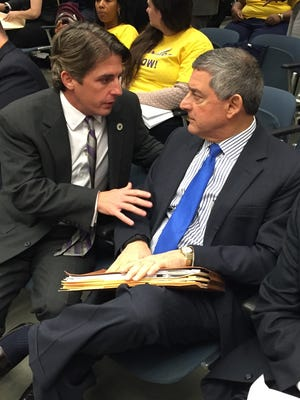 House Appropriations Chairman Cameron Henry, R-Metairie, discusses budget with Commissioner of Administration Jay Dardenne before Wednesday's committee hearing.