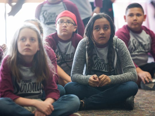 Jocelyn Flores, 10, right, sits with her classmates from Sonoma Elementary School, in Garcia Hall, listening to Vvdaul Holloway the associate resident director at Garcia Hall talk about the dormitory. Friday March 9, 2018.