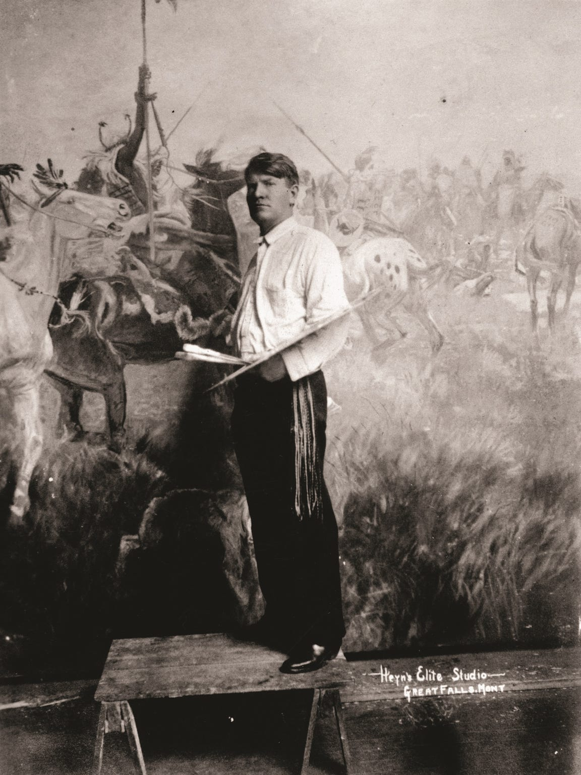 "Charlie Russell was just gaining ground as an artist in 1889. Twenty-three years later, he posed for this formal portrait in his Great Falls studio in 1912 while he was working on ""Lewis & Clark Meeting Indians at Ross' Hole"" for the Montana State Capitol."