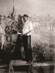 "Charlie Russell posed for this formal portrait in his Great Falls studio in 1912 while he was working on ""Lewis & Clark Meeting Indians at Ross' Hole."" The painting hangs in the senate chambers of the Montana State Capitol. Western Art Week in Great Falls is always scheduled around Russell's birthday which is Thursday."