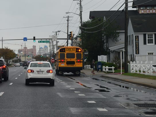 A Worcester county school bus stops along Coastal Highway