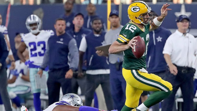 Green Bay Packers quarterback Aaron Rodgers (12) scrambles for a long first down run late in the game against the Dallas Cowboys Sunday, October 8, 2017 at AT&T Stadium in Arlington, Tx.