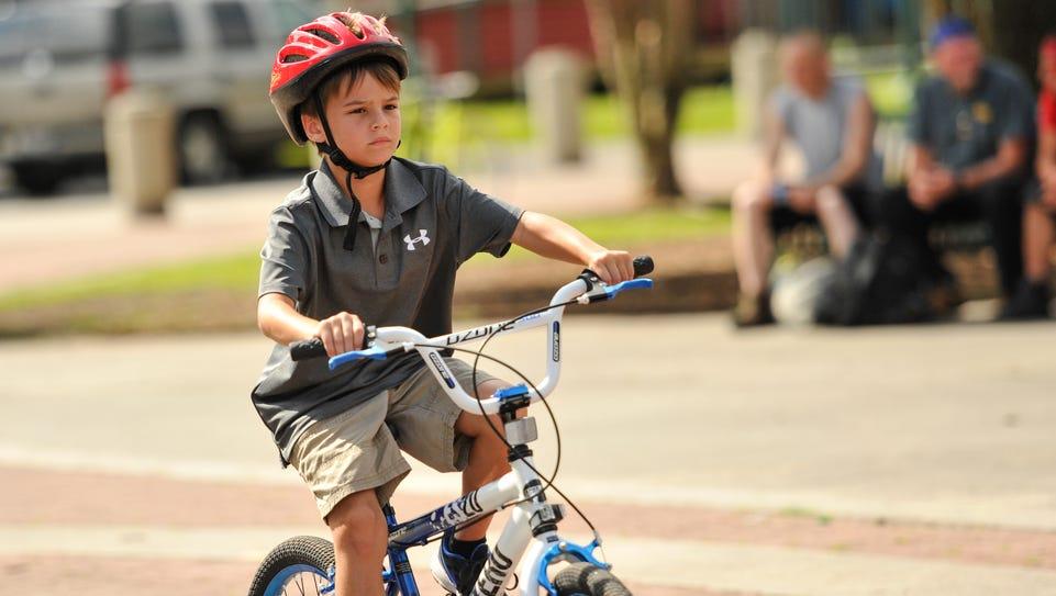 Bryce David rides his bike at Parc Sans Souci in Lafayette.