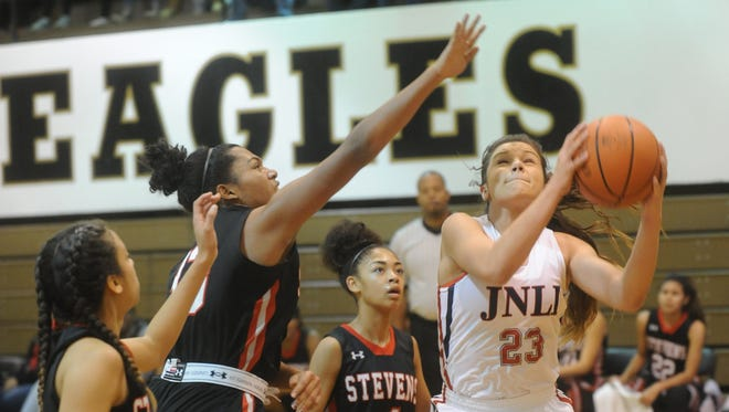 Jim Ned's Libby Tutt (23) drives for a shot against the San Antonio Stevens' defense. Jim Ned beat Stevens 55-43 Saturday, No. 19, 2016 to win the Polk-Key City Classic title at Abilene High's Eagle Gym.