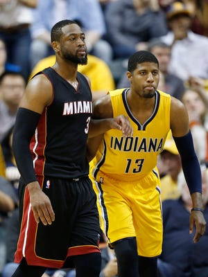 Indiana Pacers forward Paul George (13) guards Miami Heat guard Dwayne Wade (3) at Bankers Life Fieldhouse. Indiana defeats Miami 112-89.