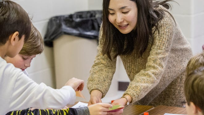 Ayaka Harui guides a classroom activity at Southeast Polk's Four Mile Elementary.
