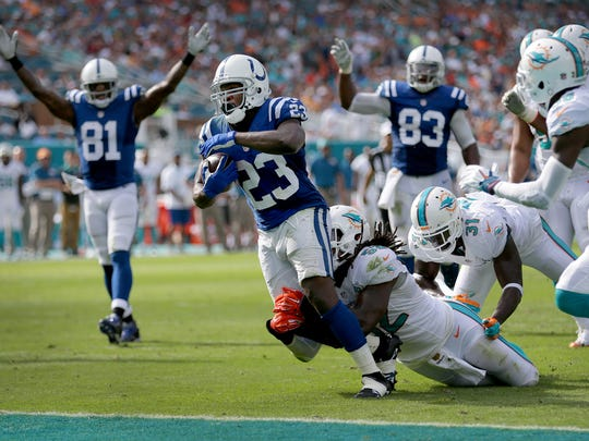 Indianapolis Colts running back Frank Gore (23) scampers in for an 11-yard touchdown in the second quarter of their game. The Indianapolis Colts play the Miami Dolphins Sunday, December 27, 2015, afternoon at Sun Life Stadium in Miami Gardens, FL.