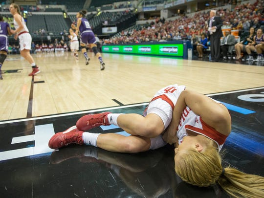 Tyra Buss lies off the baseline after landing hard on her left elbow during play against Northwestern, Big Ten Women's Basketball Tournament, Bankers Life Fieldhouse, Indianapolis, Friday, March 4, 2016. Buss would stay down for a few minutes and reentered play shortly after. Northwestern won 79-73.