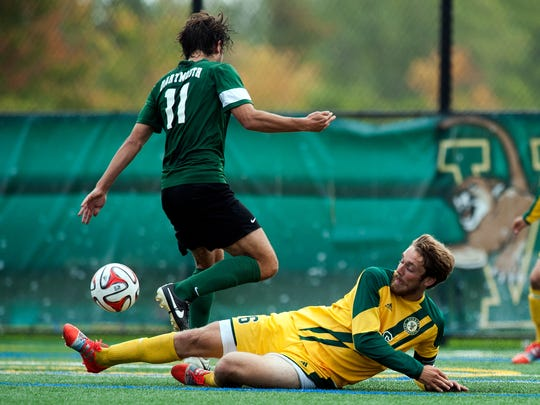 Vermont's Brad Cole (6) slide tackles Dartmouth's Giorgio Gorini (11) during a men's soccer game earlier this season at Virtue Field. After two years away from the program, Cole, a former South Burlington star, has returned as a captain for one final season with the Catamounts.