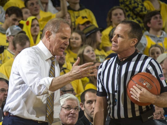 Michigan head coach John Beilein makes an argument with a game official in the first half of an NCAA college basketball game against Michigan State at Crisler Center in Ann Arbor, Mich., Sunday, Feb. 24, 2019. Michigan State won 77-70. (AP Photo/Tony Ding)