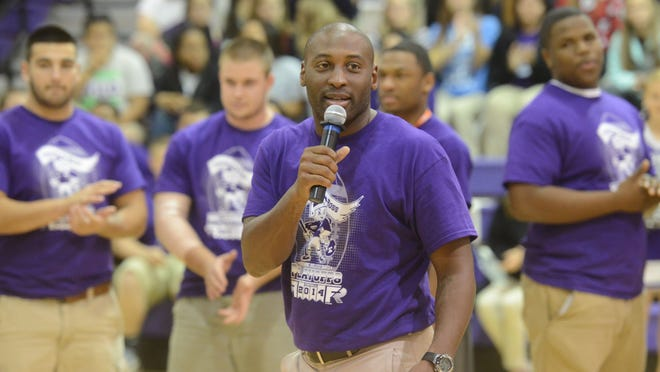 Fremont Ross head football coach Craig Yeast addresses his football players during a pep rally celebrating the football team's playoff game.