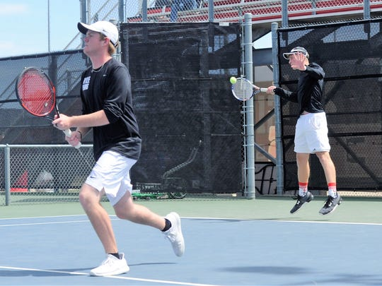 Wylie's Zane McCurley hits a shot behind boys doubles partner Cole Edwards during the Region I-4A tournament in Lubbock on Wednesday, April 18, 2018. McCurley and Edwards advanced to the semifinals Wednesday night.