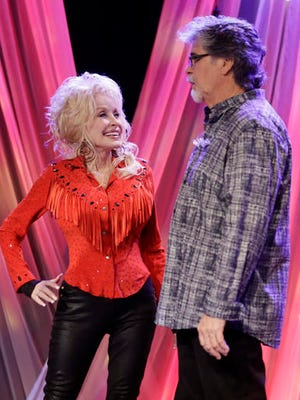 Dolly Parton talks with Randy Owen of the group Alabama during tapings for Parton's Smoky Mountain Rise Telethon Tuesday, Dec. 13, 2016, in Nashville, Tenn. Parton has lined up an all-star list of performers for a three-hour telethon to raise money for thousands of people whose homes were damaged or destroyed in Tennessee wildfires.