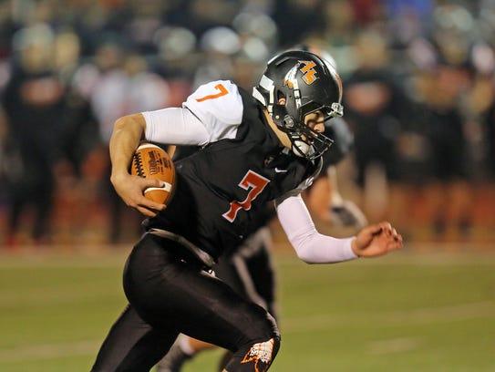 Anderson quarterback Jay Volpenhein runs for a touchdown