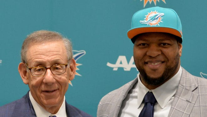 Miami Dolphins defensive tackle Ndamukong Suh (right) poses with Dolphins owner Stephen Ross (left) after a press conference at Doctors Hospital Training Facility.
