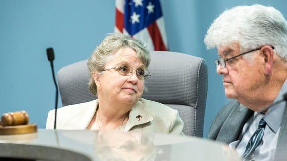 Superintendent Diane Douglas and board president Greg
