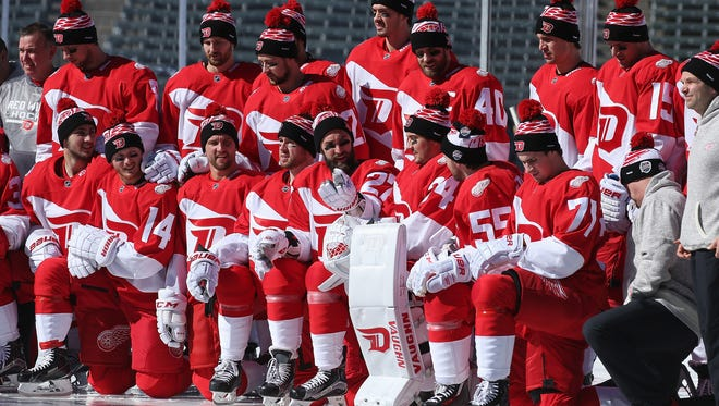 The Detroit Red Wings pose for a team photo prior to their practice skate session on the eve of their game versus the Colorado Avalanche at the 2016 Coors Light Stadium Series at Coors Field on Friday.