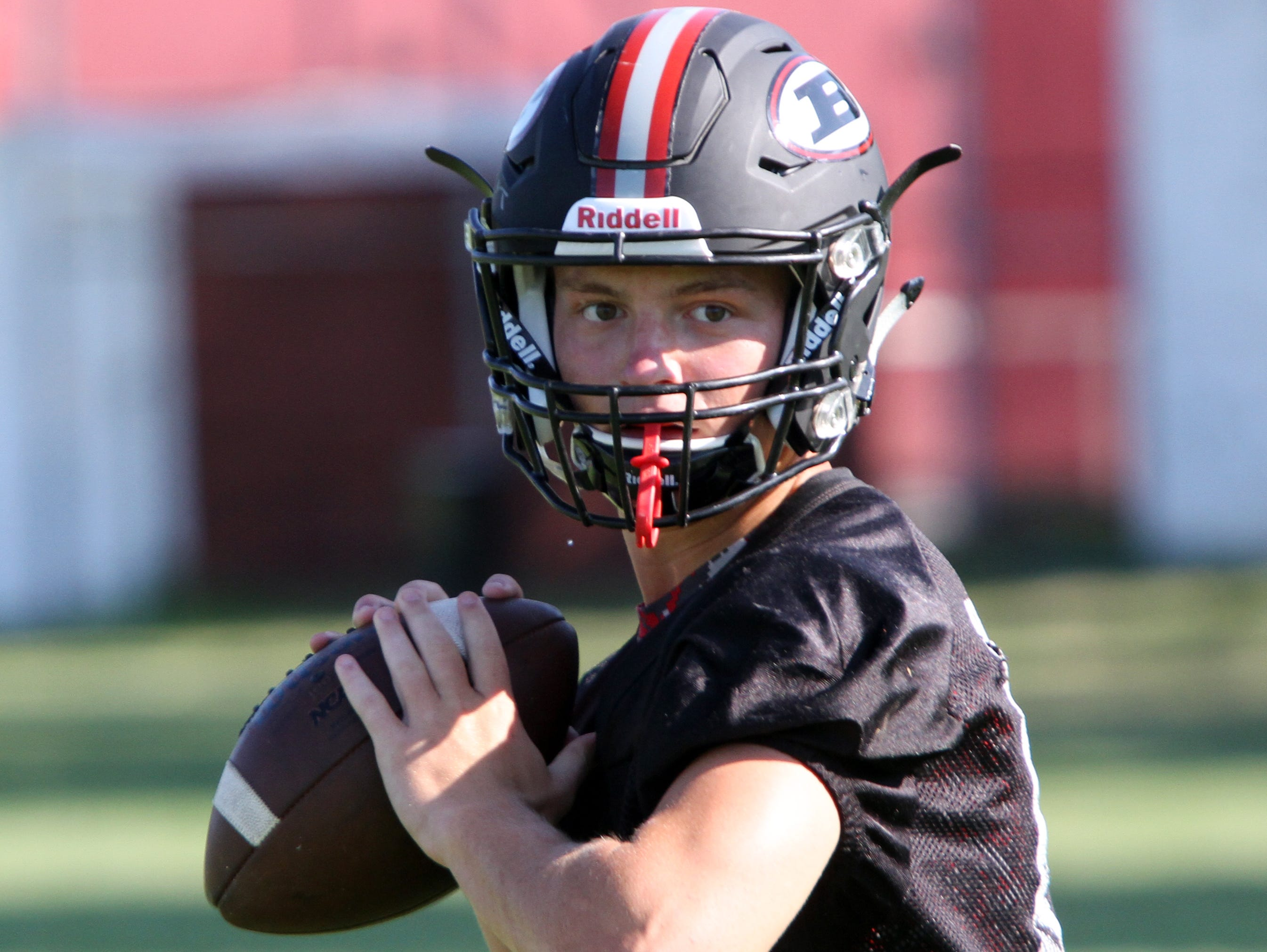 Boonton quarterback Gage Cabalar looks for an open receiver during practice back in August.