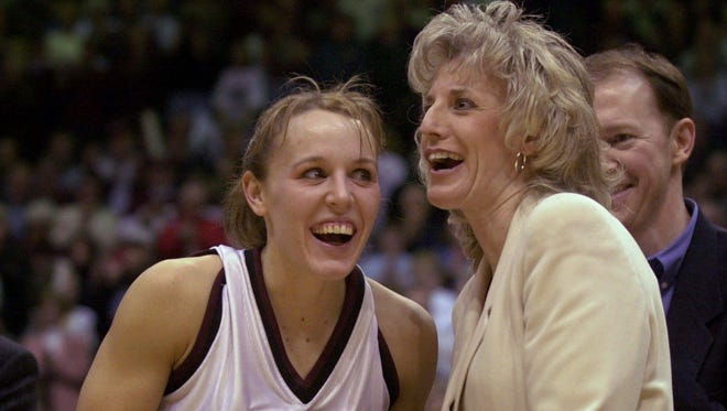 Jackie Stiles is presented with the game ball by Lady Bears coach Cheryl Burnett during a ceremony honoring Stiles for setting a new NCAA career scoring record on March 1, 2001.