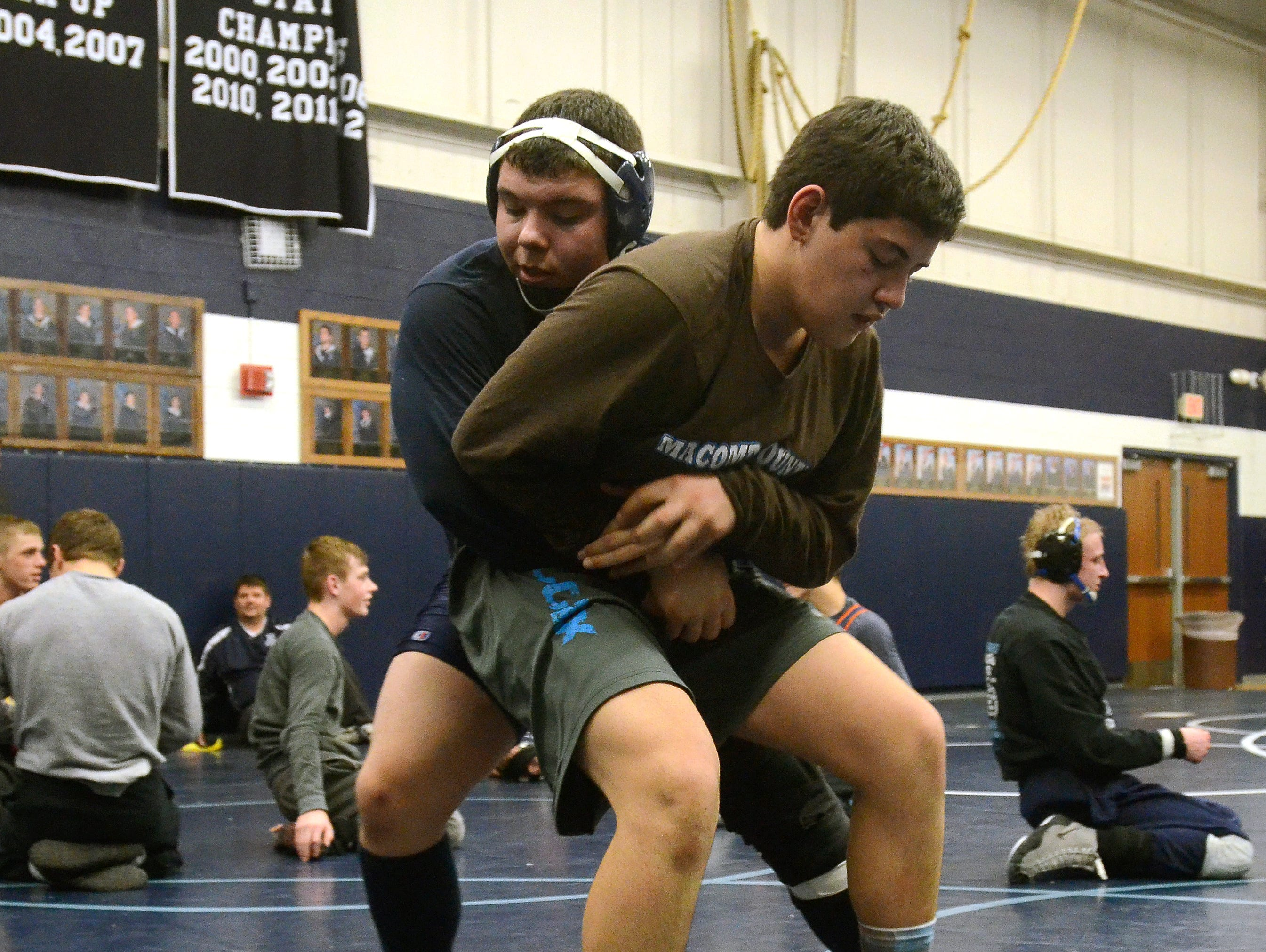 Senior, Anthony Hinojosa, left, goes through drills with Keenan Mrad, Monday, Feb 16, during wrestling practice at Richmond High School.