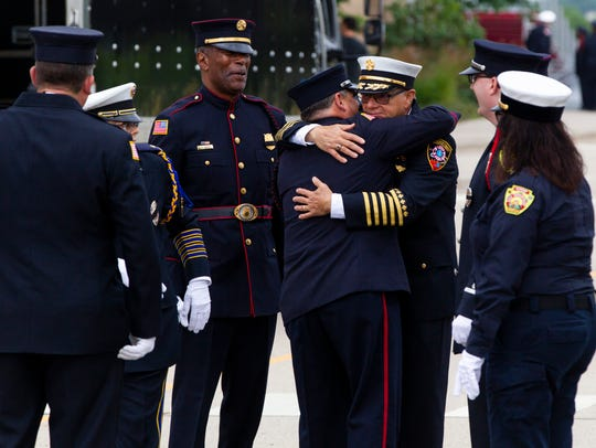 A member of the Sheboygan Fire Department embraces