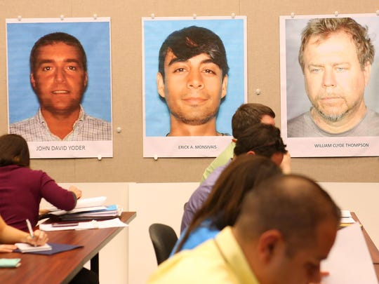 Suspect photos of John David Yoder, left, Erick Monsivais, center, and William Clyde Thompson, right, are displayed during a press conference about the suspected child porn ring in February.