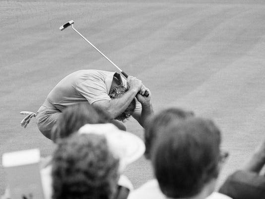"""FILE - In this June 16, 1973, file photo, Arnold Palmer bends over and raises putter after missing a birdie putt on the 12th green in the third round play of the U.S. Open golf tournament at the Oakmont Country Club Oakmont, Pa. A 3-foot-long ramp invented in the 1930s could have more say about who wins the U.S. Open come Sunday, June 19, 2016, than all the swing coaches, sports psychologists and fitness gurus in the wide world of golf combined. It's called a """"Stimpmeter"""" in honor of inventor Edward S. Stimpson and in a nice bit of serendipity, the device traces its origins back to storied Oakmont Country Club, site of this season's second major.  (AP Photo/File)"""