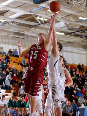 Portland's Brett Patrick, left, puts up a shot against Olivet's Ryan Wallenberg during their MHSAA regional game Monday, March 13, 2017, in Ionia, Mich.