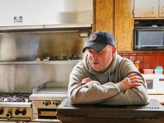 Engineer Daniel Bagwell talks about working on Christmas, sitting in the kitchen area moments before lunch at the downtown fire station in Anderson.