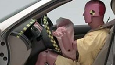 An air bag deploys in an older Honda Accord, one of the models under recall for Takata air bags. It is seen here in a crash test by the Insurance Institute for Highway Safety