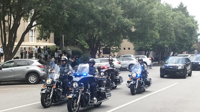 An Athens-Clarke County Police Department motorcycle unit leads the funeral procession Monday for Dale Allen.