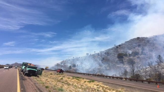 A brush fire closed State Route 87 northbound and southbound at Milepost 222, about six miles north of Sunflower, on May 20, 2018.