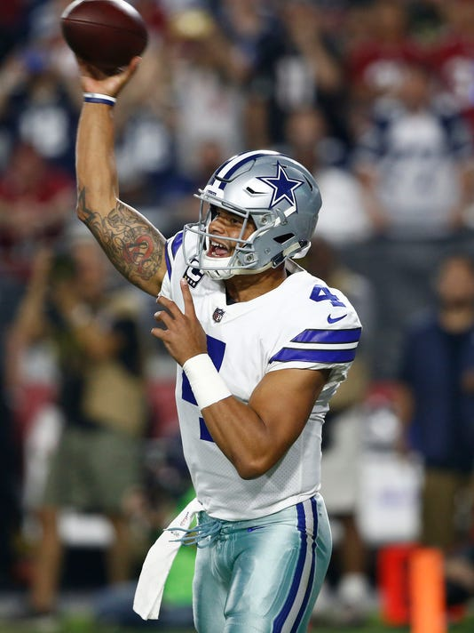 FILE-This Sept. 25, 2017, file photo shows Dallas Cowboys quarterback Dak Prescott (4) throwing against the Arizona Cardinals during the first half of an NFL football game, in Glendale, Ariz.  Carson Wentz and the Eagles have the best record in the NFL at 8-1 a year after Prescott led the Cowboys on an 11-game winning streak and the best record in the NFC when both quarterbacks were rookies. (AP Photo/Ross D. Franklin, File)