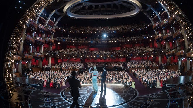 """Nicole Kidman and Chiwetel Ejiofor presenting during the 87th Academy Awards at the Dolby Theatre in Hollywood on February 22, 2015. """"I always love going to the Oscars,"""" Kidman said. """"It's nice to be invited."""" (T. Wawrychuk J. Murphy/AMPAS/Zuma Press/TNS)"""