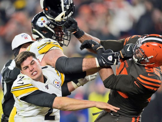 Browns defensive end Myles Garrett hits Steelers quarterback Mason Rudolph with a helmet during a game Nov. 14.