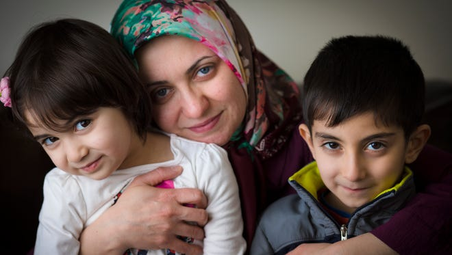 """Nakisa Azari, 37, is photographed with her children Mona Aadel, 6, and Mona, 3, in their Mason home. Her mother, Nashid Azari, 64, was supposed to land in the U.S. Saturday from Iran, but now cannot come over because of President Donald Trump's executive order on immigration. """"She's just a grandma,"""" Nakisa said. Nakisa was planning to go back to school to be an art teacher, and her mother, who had her paperwork for a greencard, was planning to help her and her husband with the kids while she was in school."""