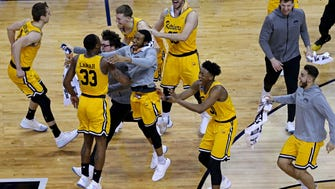 The UMBC Retrievers celebrate beating the Virginia Cavaliers in the first round of the 2018 NCAA tournament.