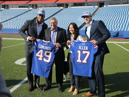 Bills first round draft picks Josh Allen and Tremaine Edmunds with owners Terry and Kim Pegula inside New Era Field.