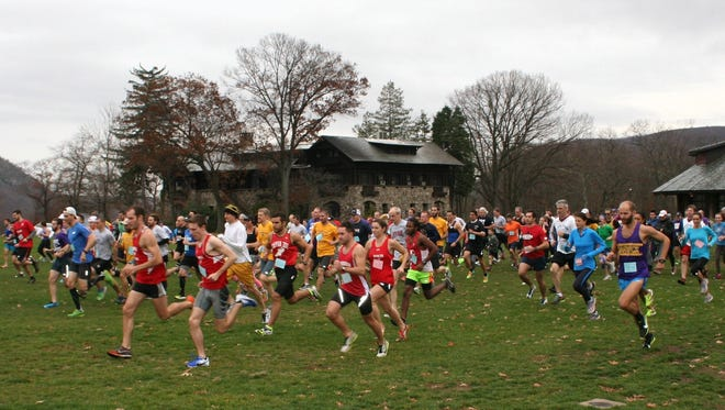 Runners in the Rockland Alumni Cross Country meet take off from the starting line at Bear Mountain State Park.