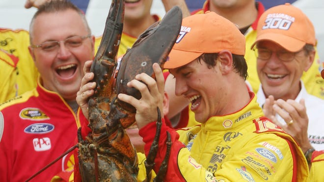 Joey Logano celebrates his second career win at New Hampshire Motor Speedway. He secured a spot in the Chase's second round.