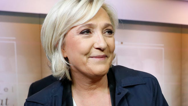 Far-right presidential candidate Marine Le Pen arrives for a television debate at French TV station TF1 in Aubervilliers, outside Paris, France, on March 20, 2017.