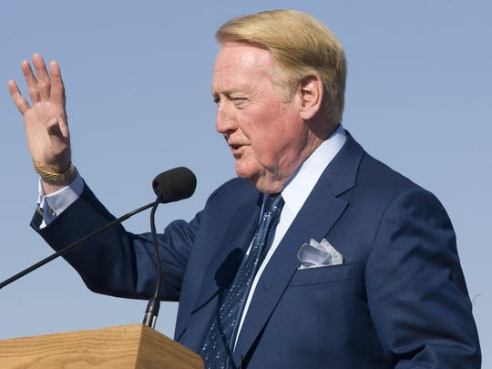 Vin Scully speaks from the podium at the groundbreaking