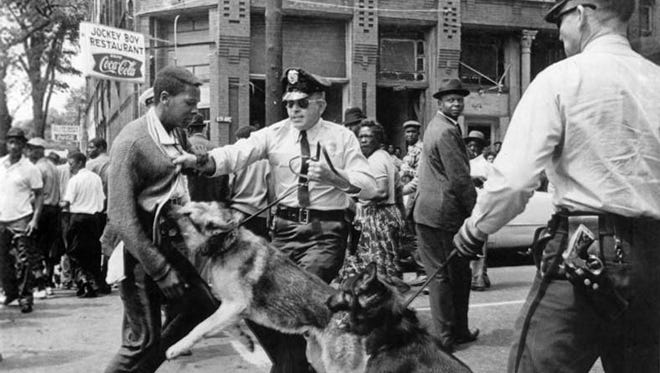 This image of Parker High School student Walter Gadsden being attacked by dogs appeared May 4, 1963, in The New York Times.