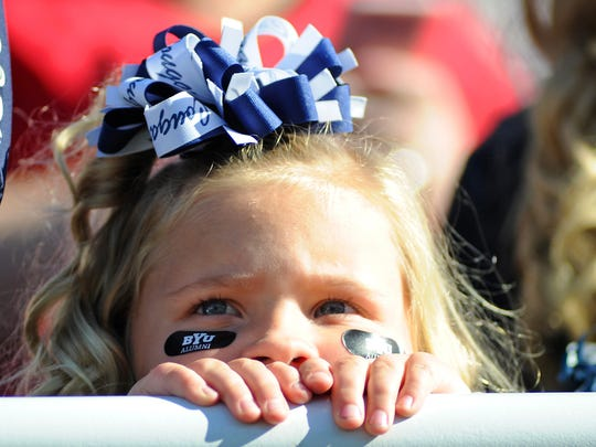 A BYU fan reacts after the Cougars are intercepted for a touchdown in the Las Vegas Bowl on Dec. 19, 2015, at Sam Boyd Stadium. The Cougars, an independent team, stand a good chance of being part of a Big 12 expansion, writes the Register's Randy Peterson.